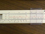 Closeup of a slide rule showing 2x3=6